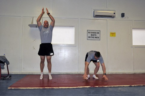 Task Force Lifeliner's Maj. William E. Laase (left), brigade logistics officer in charge for the 101st Sustainment Brigade, 101st Airborne Division (Air Assault) and Maj. Erik A. Spicer (right), the 101st Sustainment Brigade chaplain, conduct daily burpee exercises as part of their 100-day burpee challenge, Jan. 19, 2014, at Bagram Air Field, Parwan province, Afghanistan. (U.S. Army photo by Sgt. 1st Class Mary R. Mittlesteadt, Task Force Lifeliner Public Affairs)