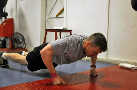 Maj. Erik A. Spicer, a native of Clarksville, Tenn., and the 101st Sustainment Brigade chaplain, assumes a push-up position during his daily burpee exercises as part of the 100-day burpee challenge, Jan. 9, 2014, at Bagram Air Field, Parwan province, Afghanistan. (U.S. Army photo by Sgt. Sinthia Rosario, Task Force Lifeliner Public Affairs)