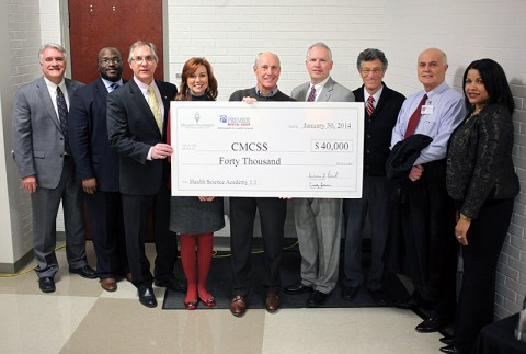 From left are: Dr. B.J. Worthington, Director of Schools; Northwest Principal Bryan Johnson; Premier Medical Dr. Peter Silkowski; Academy Administrator Theresa Muckleroy; Foundation President William Beach; Foundation member Tommy Bates; Foundation Board Member Emeritus Rudy Johnson; Foundation member and Premier Medical Group Administrator Lloyd Matson; and Foundation Executive Director Candy Johnson.