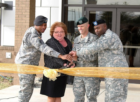 Maj. Thaddeus Burnett, the director of the Fort Campbell Defense Military Pay Office, Monica Torrence, the deputy director of the DMPO, Col. David Dellinger, Fort Campbell's garrison commander, and Lt. Col. Abel Young, the rear detachment commander of the 101st Sustainment Brigade, cut the ribbon at the grand opening of the Fort Campbell Defense Military Pay Office Jan. 16., at Fort Campbell. (Sgt. Leejay Lockhart, 101st Sustainment Brigade Public Affairs)