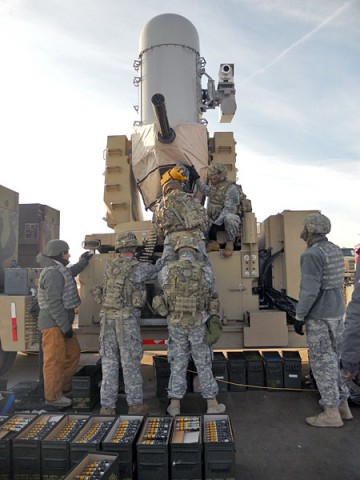 Soldiers from Battery A, 2nd Battalion, 44th Air Defense Artillery Regiment, 101st Sustainment Brigade, 101st Airborne Division (Air Assault), load ammunition into a Land-Based Phalanx Weapon System during early December, at Fort Sill, Okla. Gun crews from Battery A have the laborious task of loading and unloading the weapon's ammunition that can total up to 750 pounds per gun. (1st Lt. Lee-Ann Craig, 2nd Battalion, 44th Air Defense Artillery Regiment)