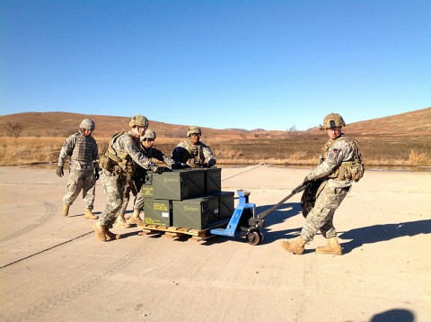 Soldiers from Battery A, 2nd Battalion, 44th Air Defense Artillery Regiment, 101st Sustainment Brigade, 101st Airborne Division (Air Assault), transport ammunition for the Land-Based Phalanx Weapon System Dec. 16, at Fort Sill, OK. The LPWS intercepts incoming indirect fire using 20 mm rounds. (1st Lt. Lee-Ann Craig, 2nd Battalion, 44th Air Defense Artillery Regiment)
