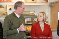 Bill Harpel speaks to Shawna Jones, Regional Director of Restaurant Operations during the Ribbon Cutting Ceremony