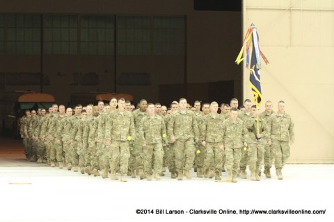 The returning soldier's march into the hanger to the cheers of their families and friends