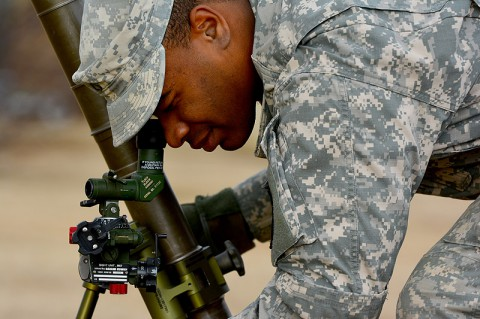 Pfc. Kelvin W. Otey, a mortarman with Company A, 1st Battalion, 327th Infantry Regiment, 1st Brigade Combat Team, 101st Airborne Division, looks down the sight of his 60 mm mortar tube during gunner preparedness training Jan. 15 at Johnson Field. (Sgt. 1st Class John Brown)