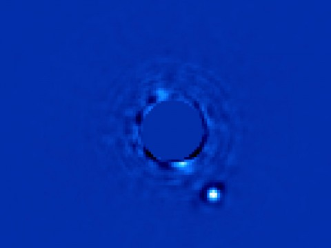 This image taken by the Gemini Planet Imager (GPI) shows a planet orbiting the star Beta Pictoris. In addition to the image, the GPI obtains spectral information from every pixel element in the field of view, allowing scientists to study the planet in great detail. (Gemini/Christian Marois, NRC Canada)