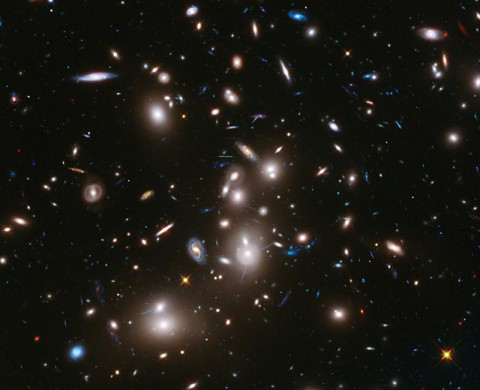 This long-exposure image from NASA's Hubble Space Telescope of massive galaxy cluster Abell 2744 is the deepest ever made of any cluster of galaxies. It shows some of the faintest and youngest galaxies ever detected in space. (NASA/ESA/STScI)
