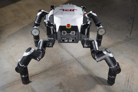 "The Jet Propulsion Laboratory's official entry, RoboSimian, awaits the first event at the DARPA Robotics Challenge in December 2013. Also known as ""Clyde,"" the robot is four-footed but can also stand on two feet. It has four general-purpose limbs and hands capable of mobility and manipulation. (JPL-Caltech)"