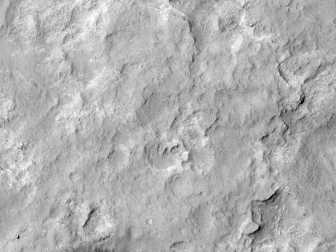 NASA's Curiosity Mars rover and tracks left by its driving appear in this portion of a Dec. 11, 2013, observation by the High Resolution Imaging Science Experiment (HiRISE) camera on NASA's Mars Reconnaissance Orbiter. (NASA/JPL-Caltech/Univ. of Arizona)