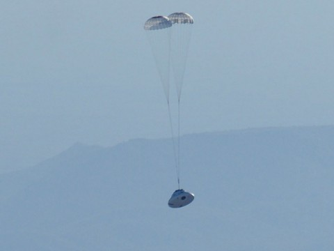 A test version of NASA's Orion spacecraft floats through the sky about the U.S. Army's Yuma Proving Ground in Arizona under the two drogue parachutes that precede the release of its three main parachutes. (NASA)