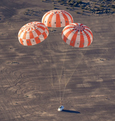 A test version of NASA's Orion spacecraft touches down in the Arizona desert after its most complicated parachute test to date. (NASA)