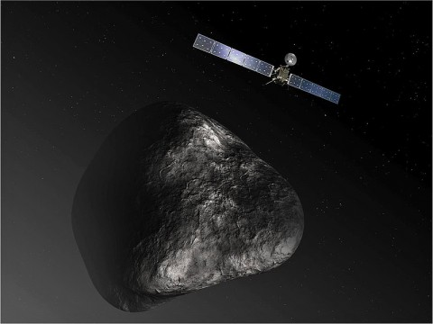 This artist's impression shows the Rosetta orbiter at comet 67P/Churyumov-Gerasimenko. The image is not to scale. (ESA/ATG Medialab)
