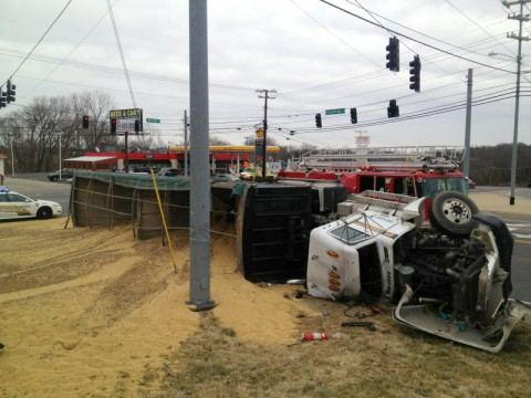 A grain truck overturned at the intersection of Tiny Town Road and Peachers Mill Road. (Clarksville Police Department)