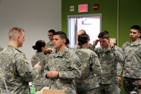 Soldiers with 2nd Battalion, 327th Infantry Regiment, 1st Brigade Combat Team, 101st Airborne Division (Air Assault), stand in line to be fitted with the new Tactical Communications and Protective System hearing device Feb. 21 at the Kinnard Mission Training Complex here. The TCAPS device is designed to provide soldiers with active hearing protection while allowing them to maintain situational awareness on the battlefield. (Sgt. Jon Heinrich/U.S. Army)