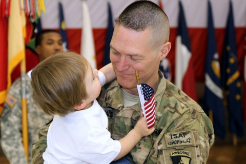 Lt. Col. Octave Macdonald, the Support Operations Officer in Charge for the 101st Sustainment Brigade, 101st Airborne Division (Air Assault), holds his son Kevin shortly after returning from a nine-month deployment Feb. 15, at Fort Campbell. The brigade provided sustainment operations and retrograde support to coalition forces in Afghanistan, performing nearly 400 convoy escort team missions across 70,000 miles of the most dangerous roads in the world. (Sgt. Leejay Lockhart, U.S. Army)
