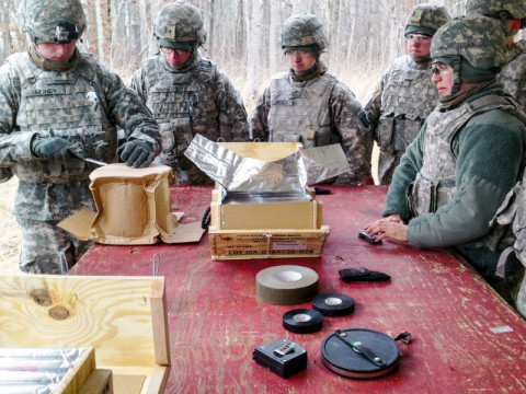 "Sgt. Jason Heiney (Left), a noncommissioned officer assigned to 591st Engineer Company, 3rd Special Troops Battalion, 3rd Brigade Combat Team ""Rakkasans,"" 101st Airborne Division (Air Assault), teaches Soldiers within his company how to prepare explosives on a range here, Jan. 24, 2014. The 591st joined the Rakkasans in January 2014 and have already spent a great deal of time at ranges to enhance their skill sets as combat engineers. (U.S. Army)"