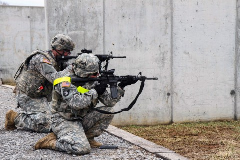 "1st Lt. Alyssa Fellows (Right) and Pfc. Michael Gray (Left), both assigned to 1st Squadron, 33rd Cavalry Regiment, 3rd Brigade Combat Team ""Rakkasans,"" 101st Airborne Division (Air Assault), fire their their M4 Carbine Rifles at the range during the 'Best Rakkasan' competition, here, Feb. 20, 2014. The competition was held was the first of its kind and was designed to measure the overall proficiency of selected teams and award them with the title of 'Best Rakkasan' through competitive events. (Sgt. Brian Smith-Dutton/U.S. Army)"