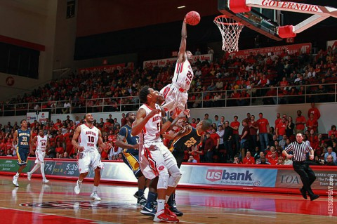 Austin Peay guard Damarius Smith puts in a monster slam over Murray State guard T.J. Sapp during Friday nights game. (Brittney Sparn/APSU Sports Information)
