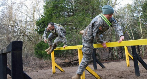 """Competitors assigned to 3rd Brigade Combat Team """"Rakkasans,"""" 101st Airborne Division (Air Assault), jump over barriers at The Sabalauski Air Assault School during the 'Best Rakkasan' competition  here, Feb. 19, 2014. The competition was held was the first of its kind and was designed to measure the overall proficiency of selected teams and award them with the title of 'Best Rakkasan' through competitive events. (Sgt. Brian Smith-Dutton/U.S. Army)"""