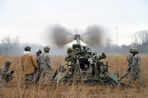 Soldiers with 2nd Battalion, 320th Field Artillery Regiment, 1st Brigade Combat Team, 101st Airborne Division, fire their M777A2 155mm Howitzer during their battalion's confidence shoot Jan. 31 at Firing Point 32A here. (Photo by Sgt. Jon Heinrich)