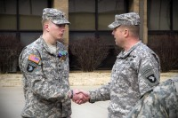 Spc. Brian D. Messersmith (left), a Soldier with Able Company, 1st Battalion, 506th Infantry Regiment, 4th Brigade Combat Team, 101st Airborne Division (Air Assault), shakes hand with Col. Val C. Keaveny Jr., commander of the 4th BCT, 101st Abn. Div., received two Army Commendation Medals, one with a Valor device, as well as a Purple Heart, during a ceremony Feb. 7, 2014. (U.S. Army photo by Sgt. Justin A. Moeller, 4th Brigade Combat Team Public Affairs)