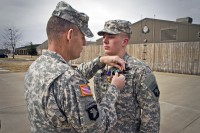 Spc. Brian D. Messersmith (right), a soldier with Able Company, 1st Battalion, 506th Infantry Regiment, 4th Brigade Combat Team, 101st Airborne Division (Air Assault), received two Army Commendation Medals, one with a Valor device, as well as a Purple Heart, from Lt. Col. Gregory Beaudoin, commander of 1st Bn., 506th Inf. Regt., 4th BCT, 101st Abn. Div., during a ceremony Feb. 7, 2014. (U.S. Army photo by Sgt. Justin A. Moeller, 4th Brigade Combat Team Public Affairs)