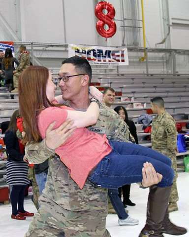 "Sgt. Stewart Thomas, a multichannel transmission systems operator-maintainer with the 58th Signal Company, 101st Special Troops Battalion, 101st Sustainment Brigade ""Lifeliners,"" 101st Airborne Division (Air Assault), embraces his fiancee Brittany Brown after returning from a nine-month deployment to Afghanistan Feb. 9, at Fort Campbell. (Sgt. Leejay Lockhart, 101st Sustainment Brigade Public Affairs)"