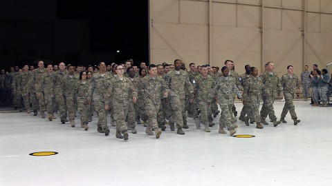 Soldiers from the 101st Sustainment Brigade, 101st Airborne Division (Air Assault), march into the hangar as they return from a nine-month deployment to Afghanistan Feb. 9, at Fort Campbell. During the deployment, the brigade provided sustainment operations and retrograde support to coalition forces throughout Afghanistan. (Sgt. Leejay Lockhart, 101st Sustainment Brigade Public Affairs)