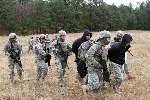 Soldiers from 1st Platoon, 218th Military Police Company, 716th Military Police Battalion, 101st Sustainment Brigade, 101st Airborne Division (Air Assault), escort detainees to a secure area during an air assault training mission Jan. 27, at Fort Campbell, Ky. Searching and interrogating detainees can yield valuable intelligence. (Sgt. Leejay Lockhart, 101st Sustainment Brigade Public Affairs)