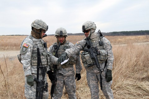 From left, Staff Sgt. Zachary Eierman, Staff Sgt. Nho Nguyen, and Staff Sgt. Rowle Boone, noncommissioned officers from 1st Platoon, 218th Military Police Company, 716th Military Police Battalion, 101st Sustainment Brigade, 101st Airborne Division (Air Assault), plan a rehearsal for detainee operations during an air assault training mission Jan. 27, at Fort Campbell, Ky. The unit trains hard to ensure everybody is proficient at their jobs in any situation. (Sgt. Leejay Lockhart, 101st Sustainment Brigade Public Affairs)