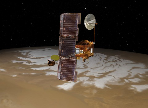 NASA's Mars Odyssey spacecraft passes above Mars' south pole in this artist's concept illustration. (NASA/JPL)