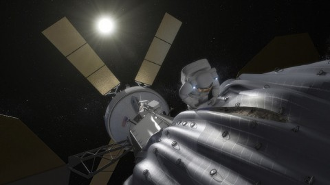 This concept image shows an astronaut preparing to take samples from the captured asteroid after it has been relocated to a stable orbit in the Earth-moon system. Hundreds of rings are affixed to the asteroid capture bag, helping the astronaut carefully navigate the surface.