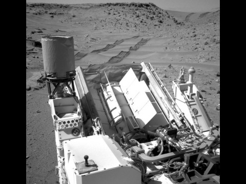 "NASA's Curiosity Mars rover used the Navigation Camera (Navcam) on its mast to catch this look-back eastward at wheel tracks from driving through and past ""Dingo Gap"" inside Gale Crater. (NASA/JPL-Caltech)"