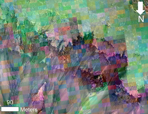 This image combines a photograph of seasonal dark flows on a Martian slope with a grid of colors based on data collected by a mineral-mapping spectrometer observing the same area. (NASA/JPL-Caltech/UA/JHU-APL)