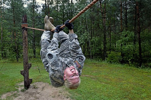 U.S. Army Spc. Elizabeth Ibabao, assigned to European Regional Dental Command, goes across a rope bridge at the obstacle course during U.S. Army Europe's Best Warrior competition in Grafenwoehr, Germany, Aug. 20, 2013. The week long event tests a soldier's physical stamina, leadership, technical knowledge and skill. (U.S. Army photo by Gertrud Zach/Released)