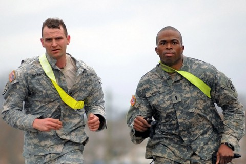 "1st Lt. Andre Shinda (right) and Staff Sgt. Robert Herendeen (left) from 3rd Battalion, 187th Infantry Regiment, 3rd Brigade Combat Team ""Rakkasans,"" 101st Airborne Division (Air Assault), race to the finish line at the final event of the 'Best Rakkasan' competition here Feb. 20, 2014. The competition tested the two-Soldier teams mentally and physically over two days in a series of eight events to determine the Brigade's premiere Soldiers. (Staff Sgt. Joel Salgado/U.S. Army)"