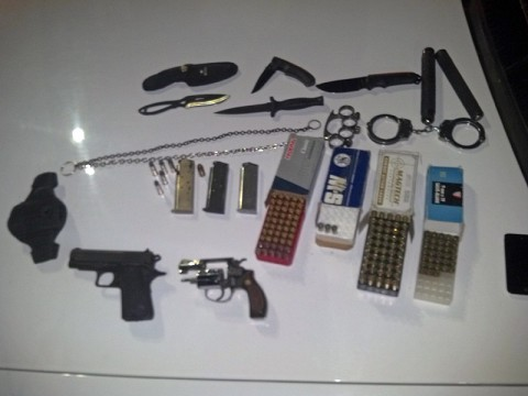 The weapons and other items found in Daniel Joseph Slusher possession.