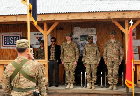 Col. Peter Benchoff (left to right), commander of 2nd Brigade Combat Team, 101st Airborne Division, Task Force Strike, Brig. Gen. Carl Alex, commander of Tactical Advise and Asset Command Northeast, and Col. Mario Diaz, commander of 4th Brigade 10th Mountain Division, Task Force Patriot, stand at attention during a transfer of authority ceremony March 3, 2014 at Forward Operating Base Gamberi. (Sgt. David Cox/U.S. Army)
