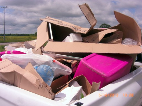 "Shown are violations of the ""Secure Load Law,"" photographed by Sgt. Mike Leutert of the Environmental Enforcement Unit."