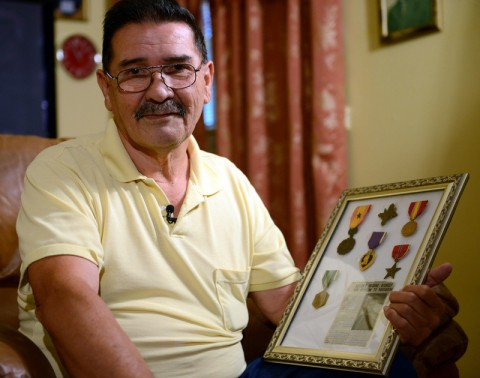 Former Spc. 4 Santiago Erevia reflects on his service medals and awards, which include a South Vietnamese medal, an Army Commendation Medal, a Purple Heart, a Bronze Star and the nation's second highest award for valor, the Distinguished Service Cross. While Erevia was deployed to Vietnam in May 1969 as a radio-telephone operator with the 101st Airborne Division, he had been assigned to care for the wounded during a search-and-clear mission while the rest of his platoon penetrated an enemy defensive perimeter. After North Vietnamese soldiers attacked his position, Erevia rushed forward into heavy fire, single-handedly destroying four enemy bunkers with grenades and M-16 fire. After reviewing Erevia's actions, President Barack Obama will award Erevia the Medal of Honor in a February 2014 ceremony. (Elizabeth M. Collins/DOD)