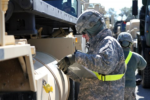Sgt. Joseph G. Anthony, a transportation management coordinator with the 632nd Movement Control Team, 129th Combat Sustainment Support Battalion, 101st Sustainment Brigade, 101st Airborne Division (Air Assault), marks vehicles during a training exercise that validates the readiness of units to rapidly deploy Feb. 26, at Fort Campbell, Ky. The readiness exercise provides valuable feedback to determine how well-prepared a unit is for rapid movement. (Sgt. Leejay Lockhart, 101st Sustainment Brigade Public Affairs)
