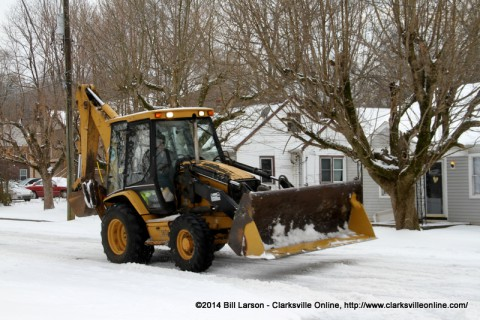 The Clarksville Street Department's Backhoe Loader heading to Gill Street