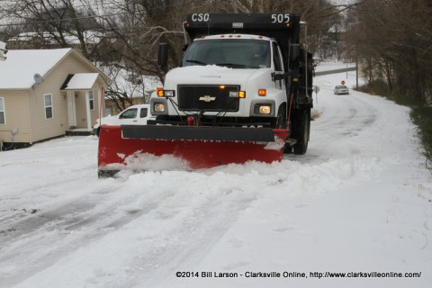 The Clarksville Street Department Snow Plow Driver finishes the job on Gill Street
