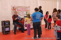 Russ Nowack from Hocus-Pocus Entertainment making baloon animals for Mega Party attendees
