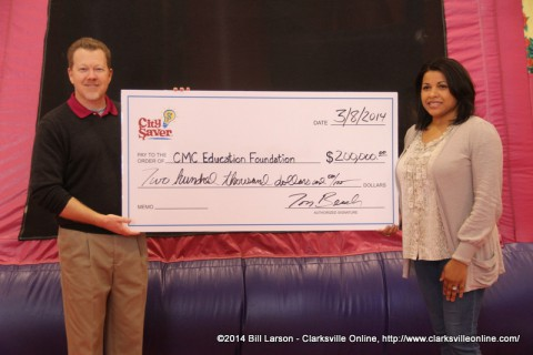 Tom Beach presents Candy Johnson from the Clarksville-Montgomery County Education Foundation a  $200,000 check.