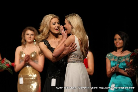 Runner-up Rachel Warren (left) congratulates Bailey Piercefield (right) as she is named as the 2014 Miss River Queen.