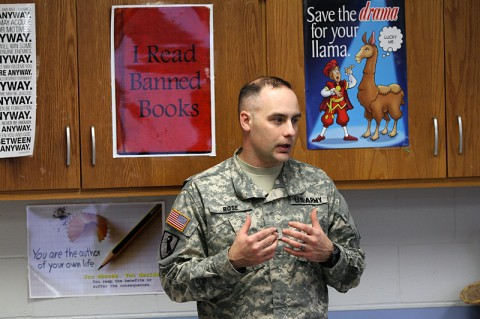 Staff Sgt. Jonathan Rose, the operations NCO of the military working dog section, 510th Military Police Detachment (Military Working Dog), 716th Military Police Battalion, 101st Sustainment Brigade, 101st Airborne Division (Air Assault), talks to students Feb. 26, at Wassom Middle School at Fort Campbell, Ky. Rose taught the students about how MPs use dogs to keep the installation safe. (Sgt. Leejay Lockhart, 101st Sustainment Brigade Public Affairs)