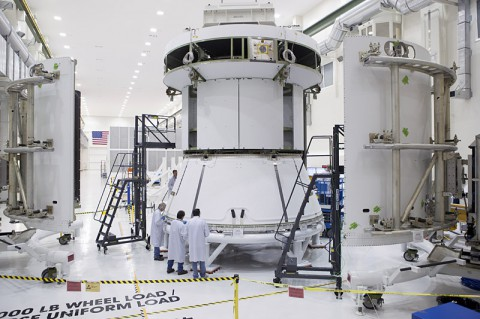 Engineers prepare Orion's service module for installation of the fairings that will protect it during launch this fall when Orion launches on its first mission. The service module, along with its fairings, is now complete. (NASA)