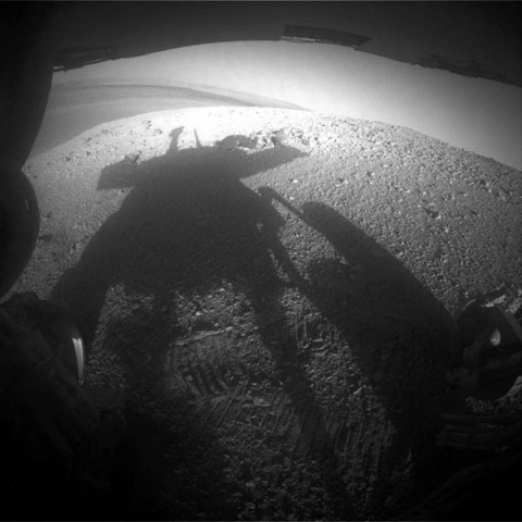 NASA's Mars Exploration Rover Opportunity caught its own silhouette in this late-afternoon image taken by the rover's rear hazard avoidance camera on March 20th, 2014. (NASA/JPL-Caltech)