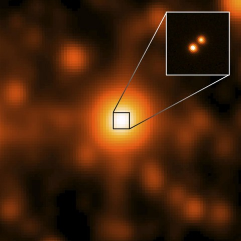 The third closest star system to the sun, called WISE J104915.57-531906, is at the center of the larger image, which was taken by NASA's Wide-field Infrared Survey Explorer (WISE). (NASA/JPL/Gemini Observatory/AURA/NSF)
